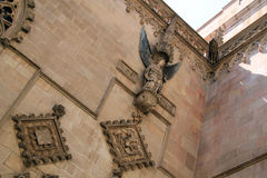 Angel relief sculpture on stone wall on church in Barcelona. Sculpture of winged angel on stone wall with decorative features on church in Barcelona, Spain royalty free stock photo