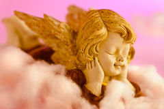 Angel resting on clouds and enjoying the sun Royalty Free Stock Photo