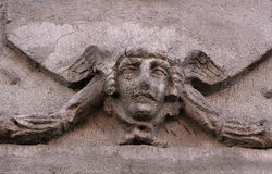Angel's head, a fragment of of ancient granite sculpture Royalty Free Stock Image