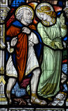 Angel and Saint Leonard of Noblac. An Angel pointing towards heaven with Saint Leonard of Noblac, just released from his shackles - shown at the bottom of the stock photo