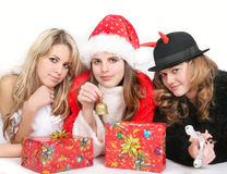 Angel, Santa and tweedledum. Portrait of girls in red Santa´s, angel´s and tweedledum´ s costume stock image