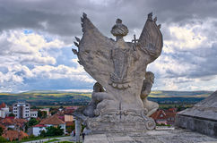 Angel satue and town of Alba Iulia, Romania Royalty Free Stock Photos