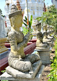 Angel sculpture lined old stone temple Royalty Free Stock Photo