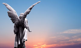 Angel sculpture over bright sky Stock Images