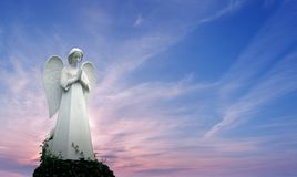 Angel sculpture over bright sky Royalty Free Stock Photos
