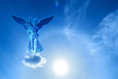 Angel sculpture over bright sky Stock Image