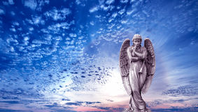 Angel sculpture over bright sky Royalty Free Stock Image