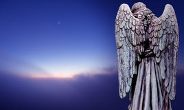 Angel sculpture over dark sky panoramic view Royalty Free Stock Image