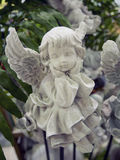 Angel sculpture. Picture of the angel sculpture as a garden decorate item Stock Image