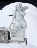 Angel sculpture in the snow. Royalty Free Stock Image