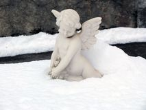 Angel sculpture in the snow. Stock Photography