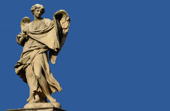 Angel shows Jesus' veil (with copy space). Marble statue of angel from the Sant'Angelo Bridge in the very centre of Rome (17th century Stock Photos