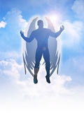 Angel. Silhouette illustration of an angel figure on clouds background Stock Image