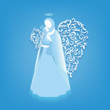Angel silhouette of mother and child with ornaments wings. Angel silhouettes of mother and child with ornamental floral white wings and glowing nimbus on a blue Royalty Free Stock Image