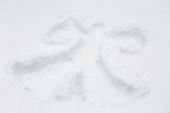 Angel silhouette or print on snow surface Royalty Free Stock Images