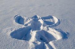 Angel silhouette winter snow made human Stock Photos