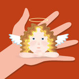 Angel sits on palm Royalty Free Stock Photos