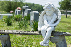 Angel Sitting on Stone Bench in Cemetery Royalty Free Stock Photos