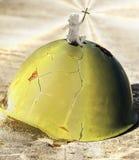 Angel sitting on a war helmet. Stock Images