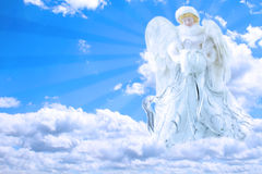 Angel in Sky. Beautiful generic angel praying in the sky with rays of light coming from behind her Royalty Free Stock Photos