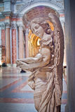 Angel in the sky. Bronze statue of an angel on one of the famous churches of Rome Royalty Free Stock Photography