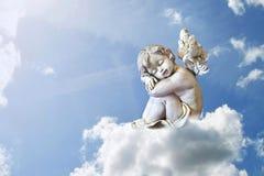 Angel sleeping on the cloud Stock Photos