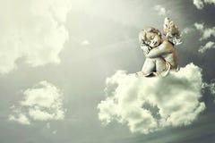 Angel sleeping on the cloud Stock Photography