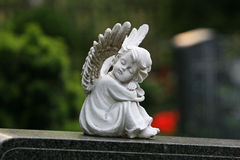 Angel sleeping at graveyard Stock Image
