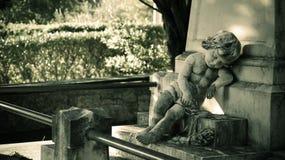 Angel is sleeping!. Sleepy angel, stone statue. Rest beside the grave Stock Photo