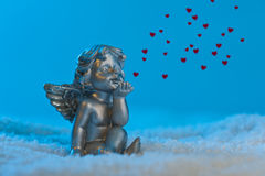 Angel in snow setting shows heart Stock Photography
