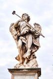 Angel with Sponge statue on Ponte Sant Angelo bridge in Rome, Italy Stock Photo