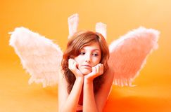 Angel With Spread Wings. An angel laying on the ground with spread wings royalty free stock images