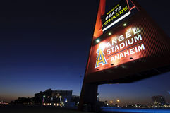 Angel Stadium. Anaheim,CA April, 2011. The Big  A and the Angel Stadium in the background at twilight at the start of the 2011 season in Anaheim Royalty Free Stock Image