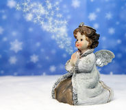 Angel with star dust Stock Images