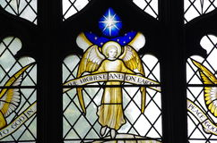 Angel with star in stained glass Royalty Free Stock Photo
