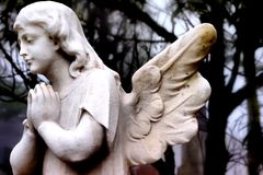 Angel statue. A statue of an angel praying Stock Images