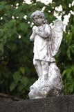 Angel statue. Weathered stone statue of an angel Royalty Free Stock Image