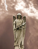 Angel statue. Angel holding a cross statue Stock Photos