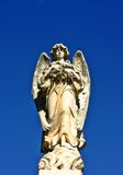 Angel Statue. Against bright blue sky Royalty Free Stock Photography