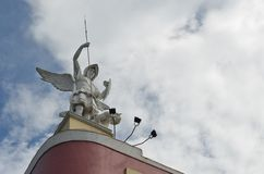 2014: Saint Micheal`s Cathedral Statue, Iligan City, Philippines. Angel Statue above the Cathedral Church, photo taken during noon time Royalty Free Stock Photo