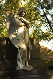 Angel. Statue of an angel on the autumn cemetery royalty free stock images
