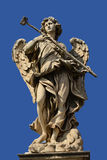 Angel statue with blue sky. The magnificent bridge of Sant'Angelo with Bernini's marble angels Stock Photo