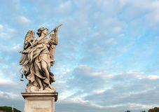 Angel statue on the bridge of Castle Sant'Angelo, Rome. Royalty Free Stock Photography