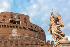 Angel statue on the bridge of Castle Sant'Angelo, Rome. Royalty Free Stock Images