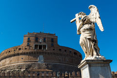 Angel statue on a bridge in front of the Castel Sant`Angelo in R Stock Photography