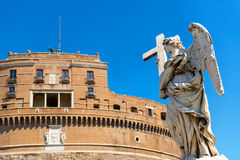 Angel statue on a bridge in front of the Castel Sant`Angelo, Rom Stock Image