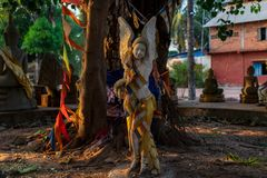 Angel statue in the buddha circle at a Cambodian temple royalty free stock photography