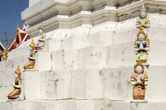 Angel statue on building and chedi of Wat Wachirathammasatit. Or wat thung satit temple for thai people pray and respect in Bangkok, Thailand Royalty Free Stock Photo