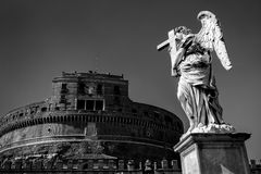 Angel statue and Castel Sant`Angelo in Rome Stock Image