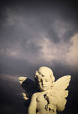 Angel statue in a cemetery. Angel statue against a stormy sky. Waverley Cemetery, Clovelly Bay, Sydney, Australia Stock Photo